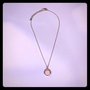Gold necklace with pink spinning pendant